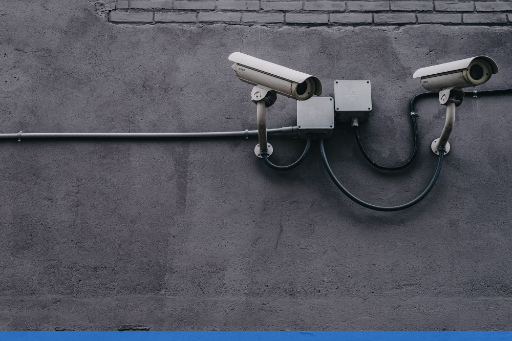 Close up of 2 security cameras pointing to the right