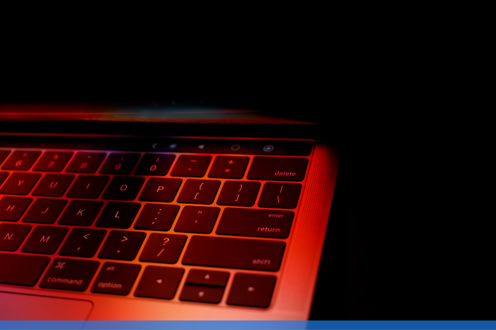 close up of laptop keyboard under a red light