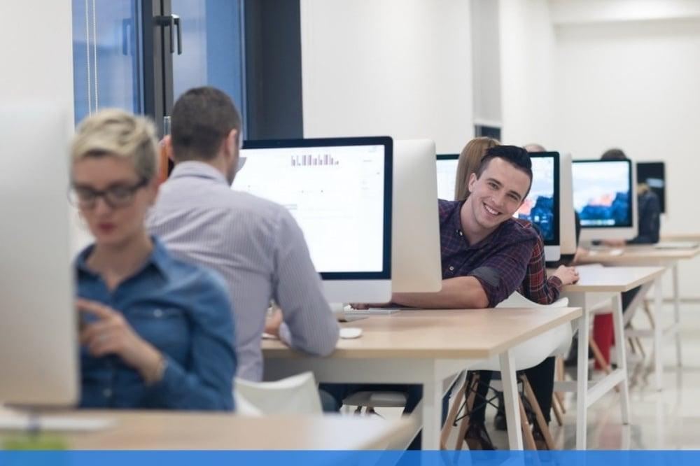 Students working together at work desk
