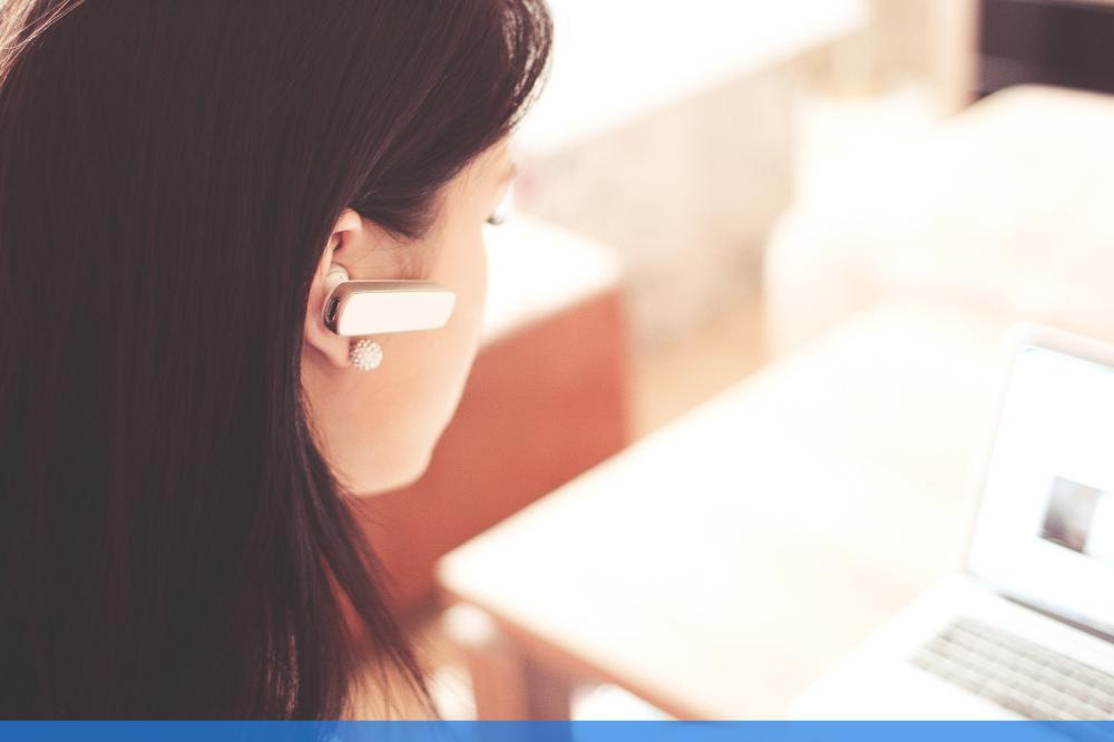woman communicating via ear device