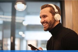 young man using bluetooth headphones